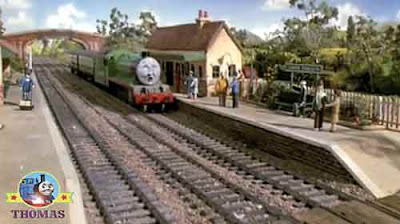 Lower Tidmouth station platform people waiting with Henry the green engine on a railway train bridge