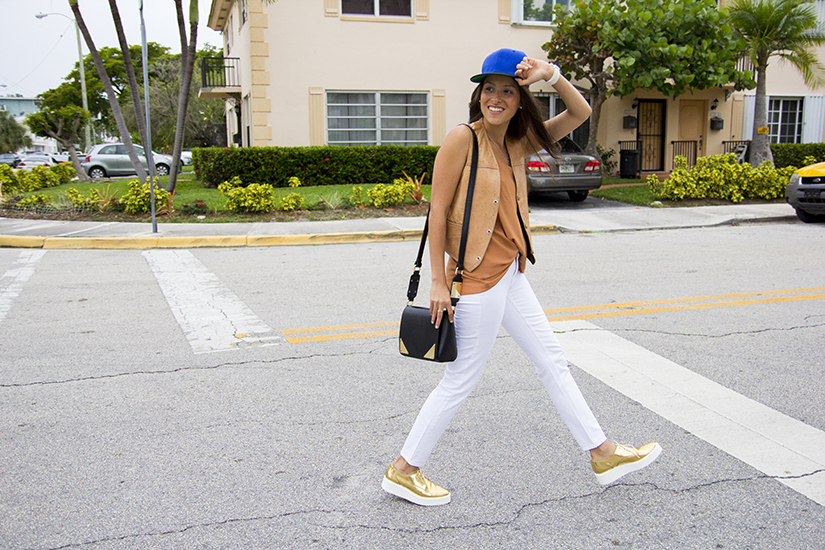 Maria Copello fashion blogger is wearing a vintage leather vest, white skinny jeans from Madewell, and gold platforms from Zara.