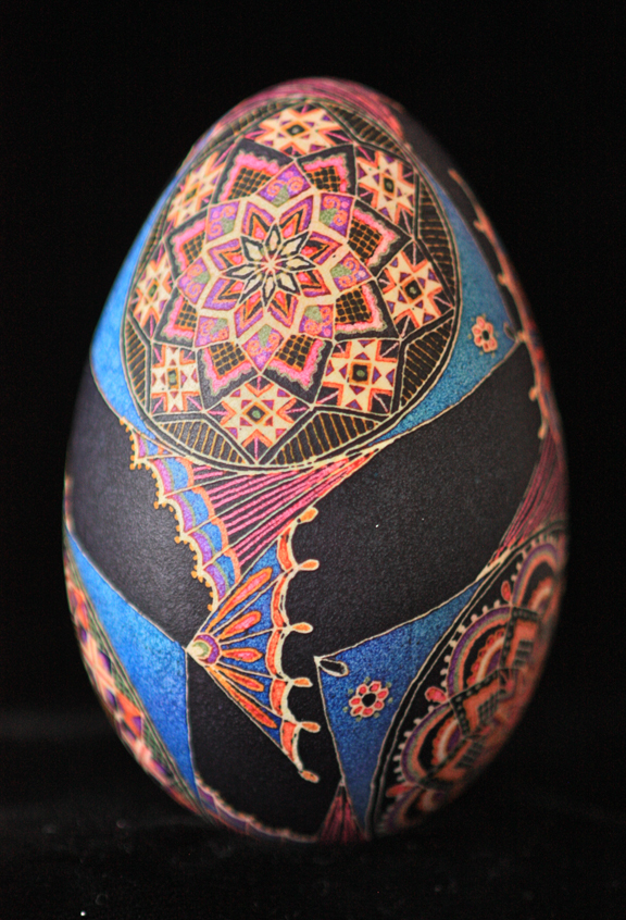 Goose Egg Pysanky with Colorful Tropical Fish on Black Background in Interlocking Pattern