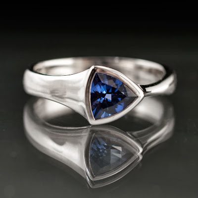Trillion lab created sapphire ring in palladium