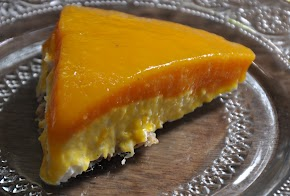 A soft creamy no bake cheesecake: Mango cheesecake with an almond-honey crust...