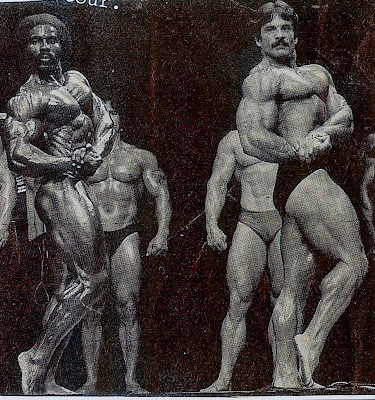 "ROBBY ROBINSON AND MIKE MENTZER - POSE DOWN Read about RR's training and life experience, about other legends  of Golden Era of bodybuilding and what really happened  behind the scenes of Weider's empire - in RR's BOOK  ""The BLACK PRINCE; My Life in Bodybuilding: Muscle vs. Hustle"" -  ▶ www.robbyrobinson.net/books.php"