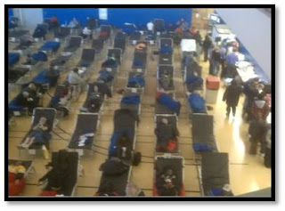 A gymnasium at Lehman College serves as a makeshift shelter for displaced residents