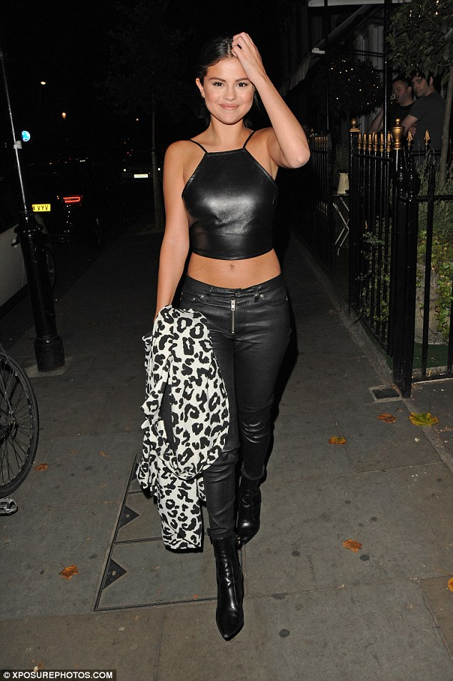Selena Gomez in a leather cropped top at 23rd birthday celebrations