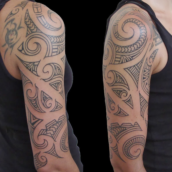 maori influenced arm tattoo
