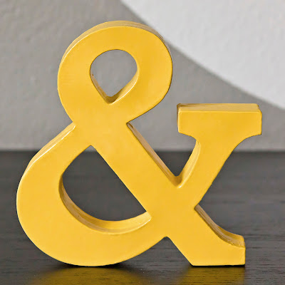cardstock ampersand, made by layering cardstock cut with Cricut