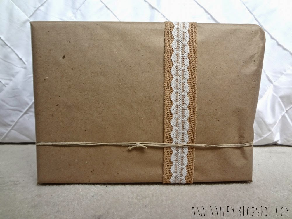 Brown paper gift wrap with burlap, lace and hemp twine
