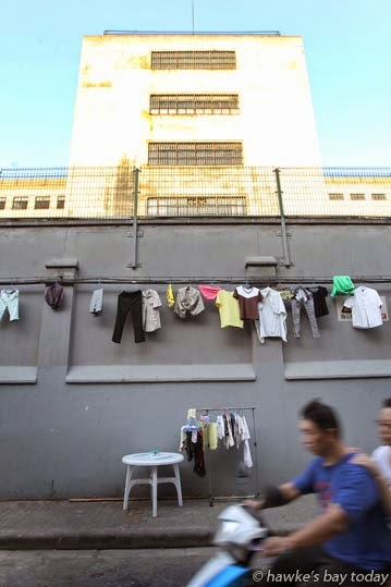 Washing hung out to dry on the walls of the local prison photograph