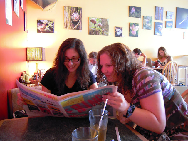 "Fellow Blogger Danielle, and friend Larissa reading the local newspaper in the ""My Dog Joe"" cafe."