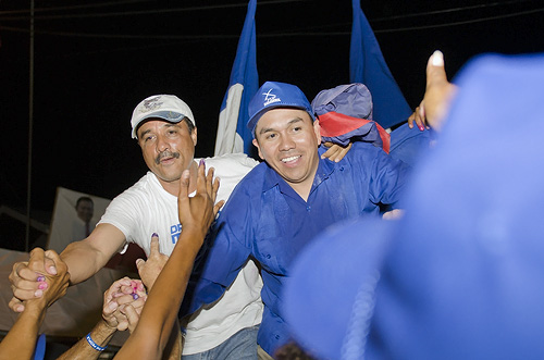 Dr. Marco Tulio Mendez (left) and Ex-UDP minister Marcel Cardona share the spoils of victory in Orange Walk East elections, March 7, 2012.