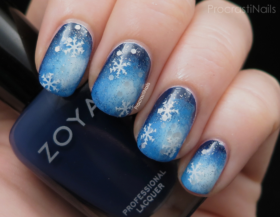 Frozen nail art with a gradient and snowflakes using Zoya