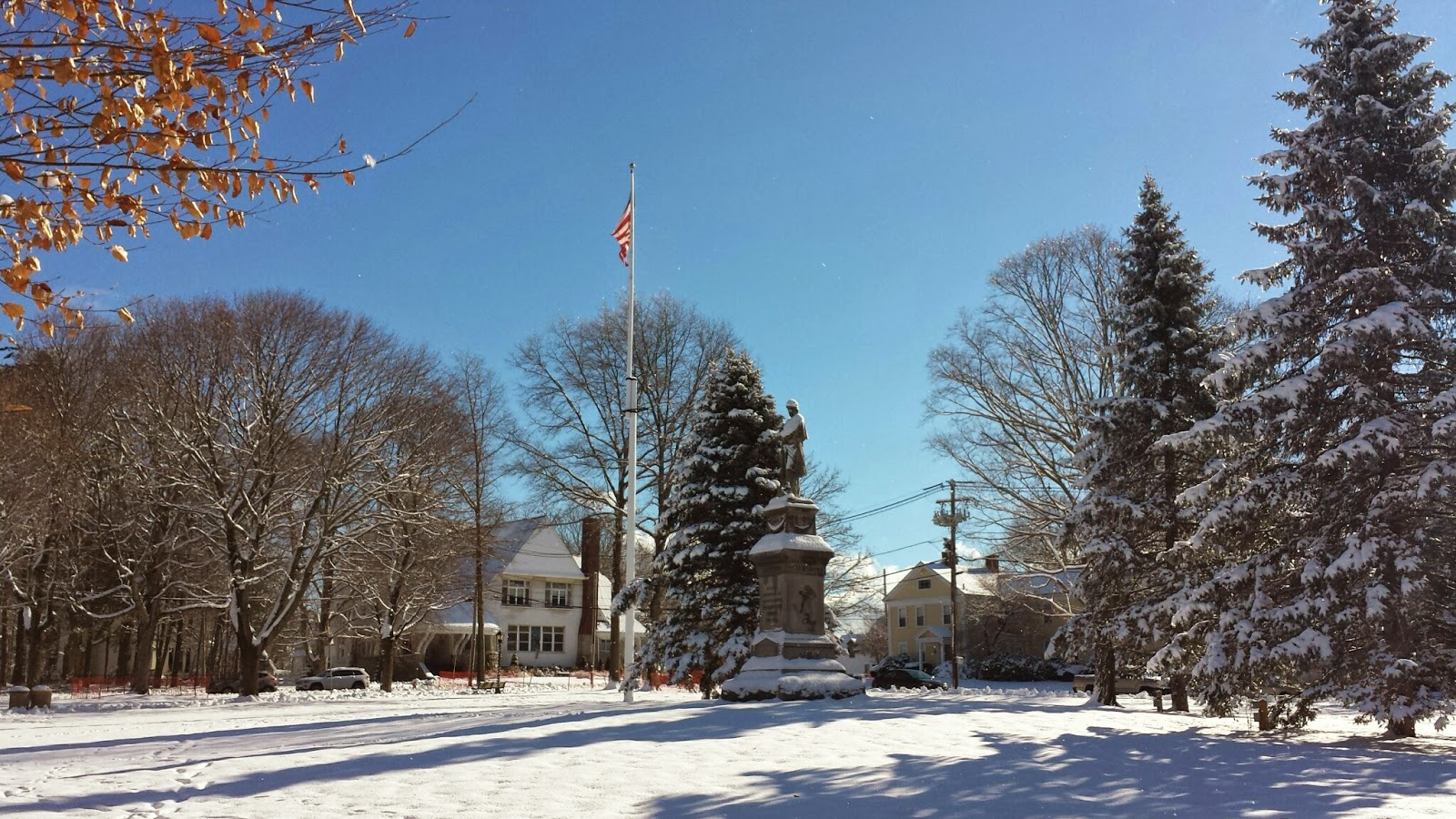 on the High St side of the Town Common, the spruce trees and Civil War memorial cast long shadows