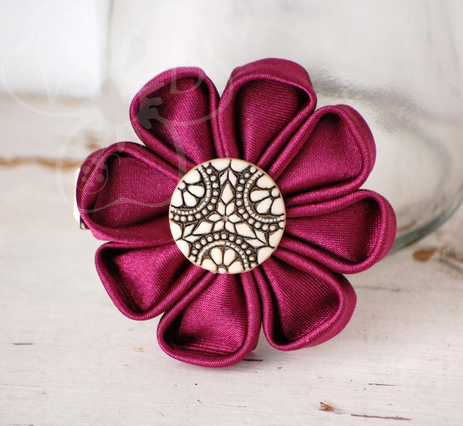http://violetsbuds.storenvy.com/collections/220228-kanzashi-flowers/products/5552263-vintage-merlot-kanzashi-flower-hair-clip