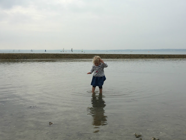 Tin Box Tot paddling in the sea