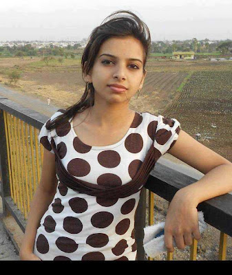 Modern tamil college girl wearing sleeveless long tops.