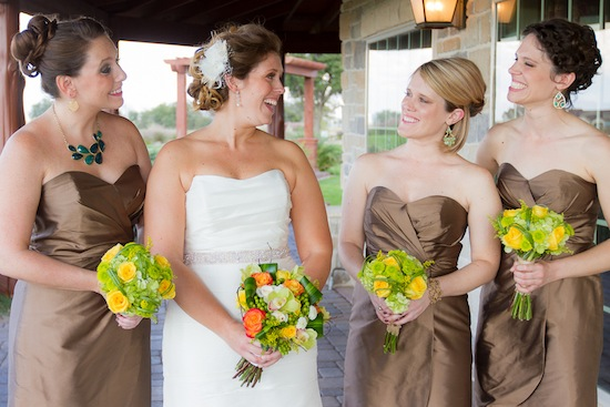 bride smiling with her bridesmaids before the wedding