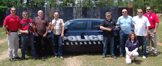 At the Shenandoah Police Department, Denham (far right) trained Polish National Police in firearms.