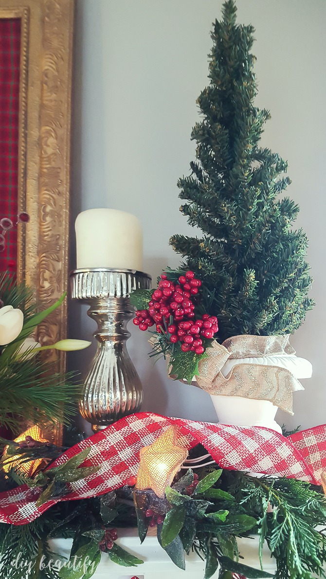 I'm sharing some tips for decorating a festive Christmas mantle sure to get you in the holiday spirit! See more at diy beautify!