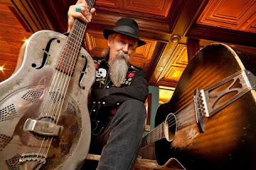 Doc MacLean w. guitars PIC