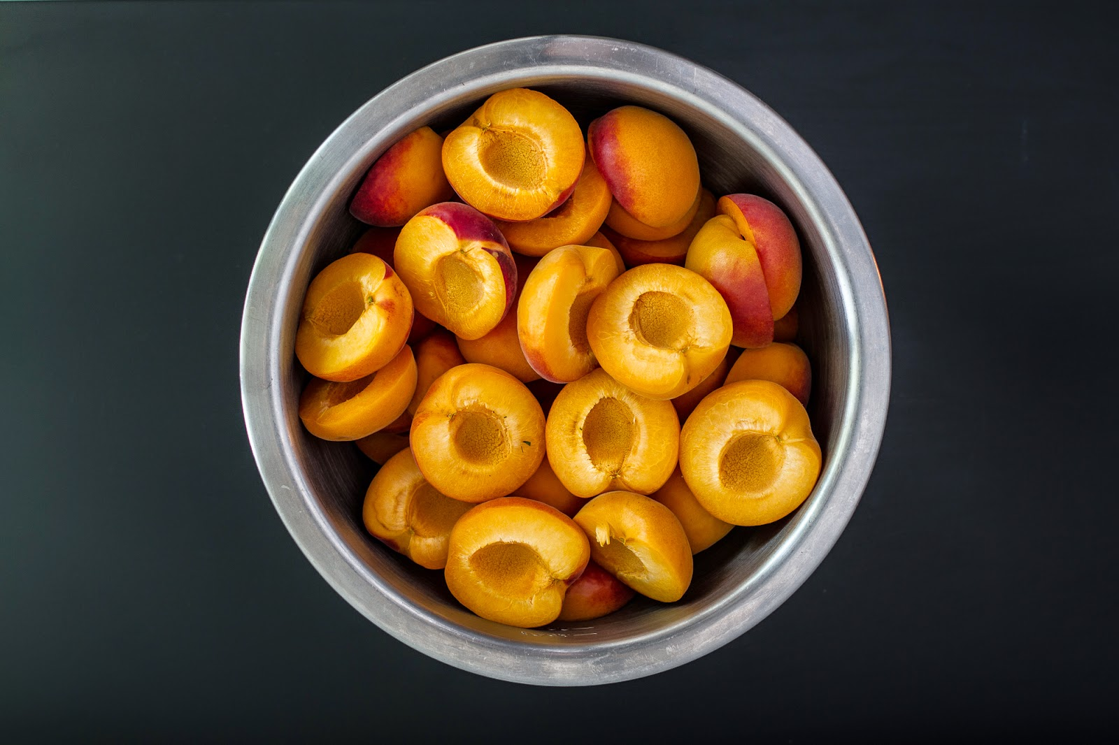Halved and pitted apricots