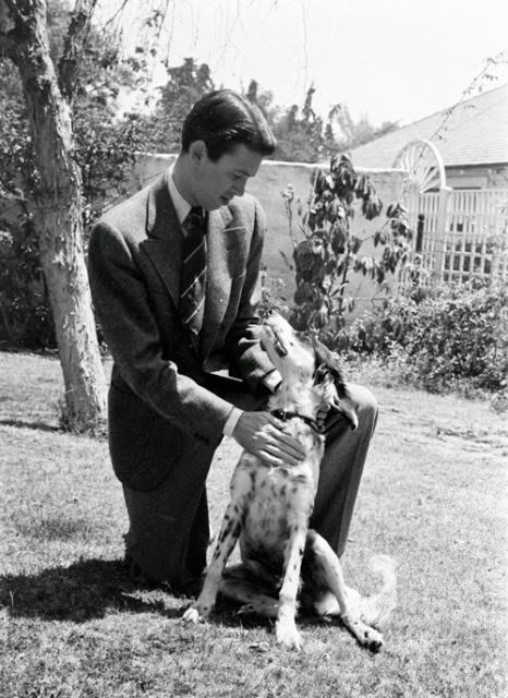 Jimmy Stewart with his dog in the yard.