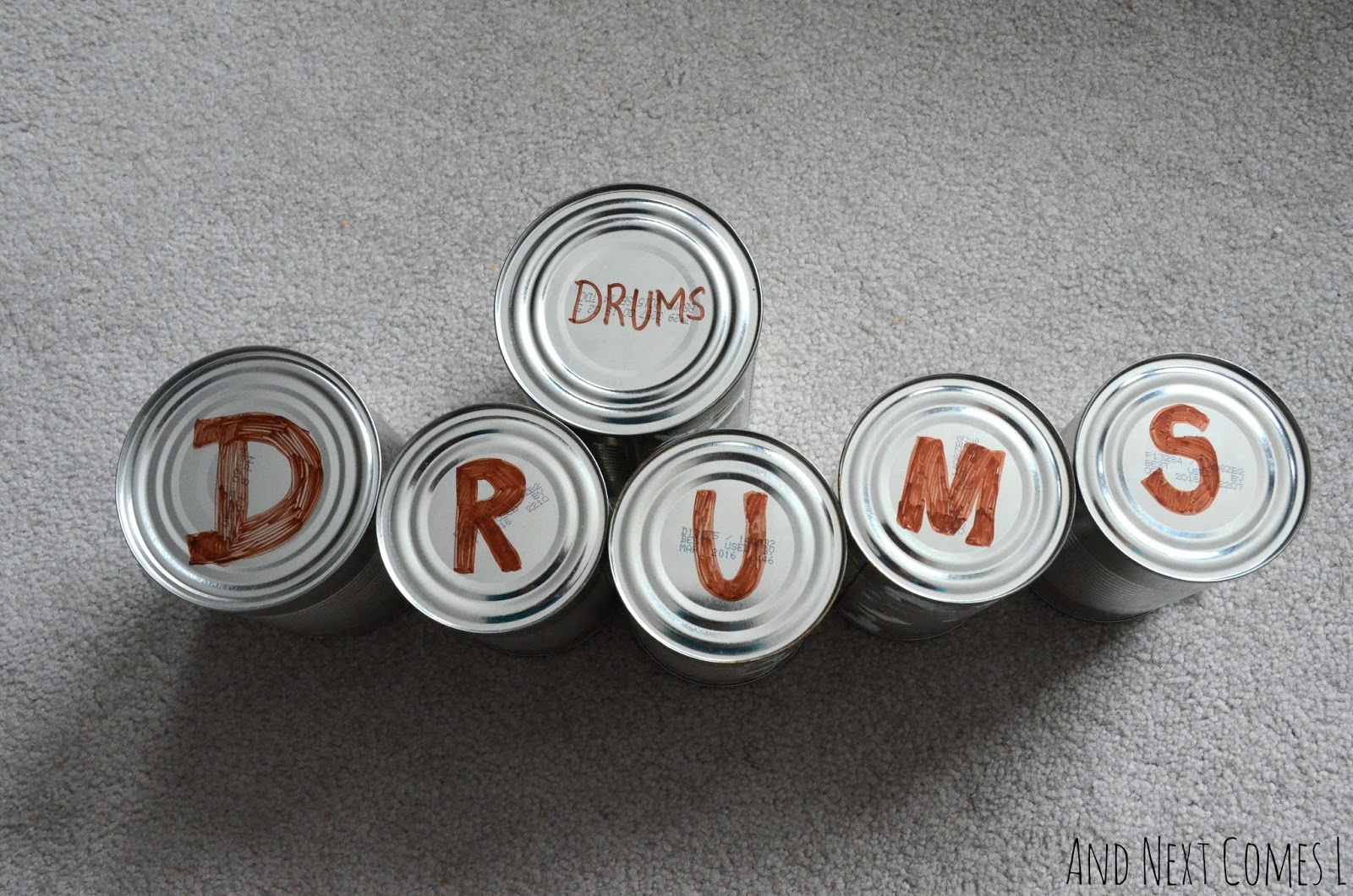 Explore music and literacy with this tin can drums spelling activity for kids from And Next Comes L