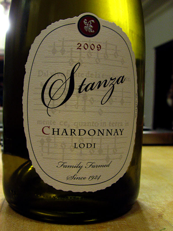 Stanza Chardonnay with gregorian chant music notation