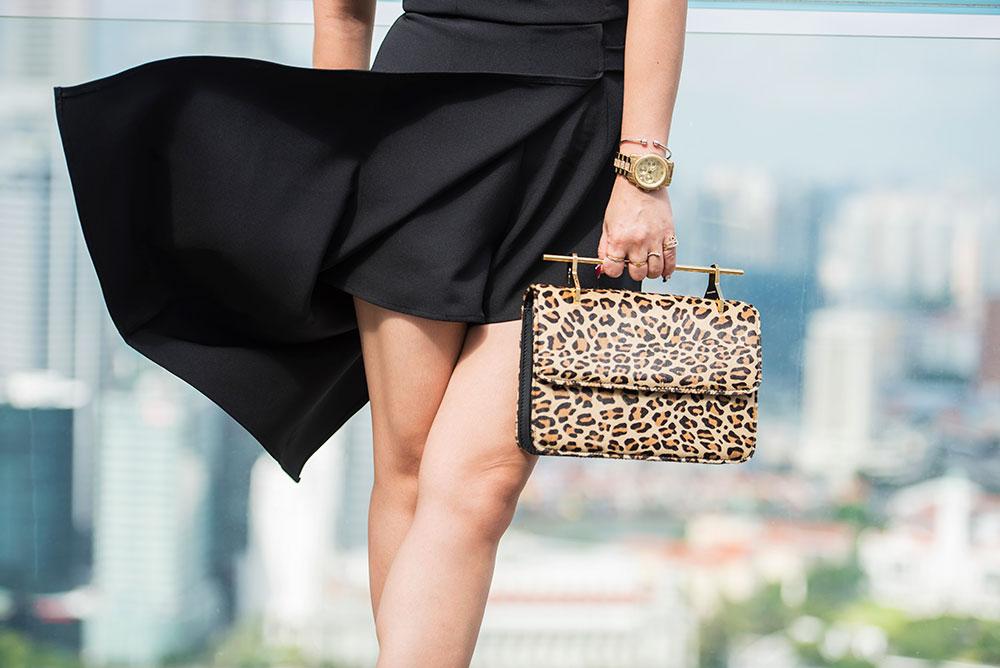 Crystal Phuong- Revolve Clothing- NBD Black Romper & M2Mallerlier leopard bag