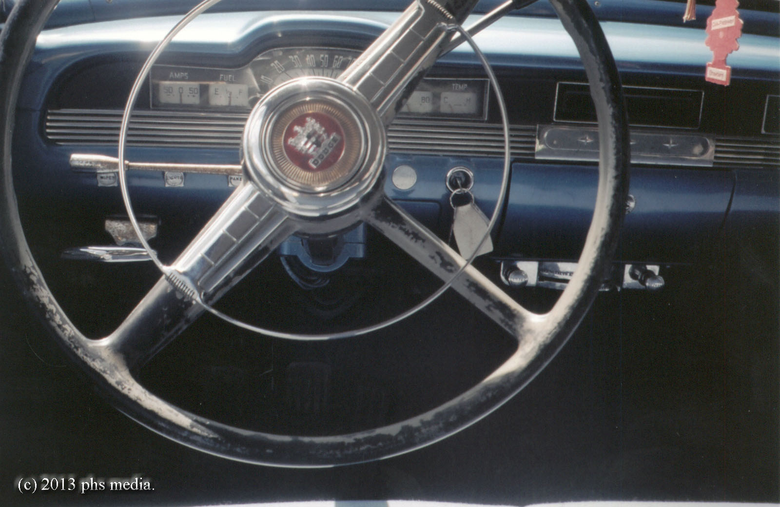 Inside it was a Cranbrook dashboard with Dodge steering wheel. Again, the  centercap is different from the American Coronet offering.