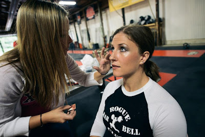 Kate Rawlings gets make-up done for the Coca CrossFit women's beauty shoot.