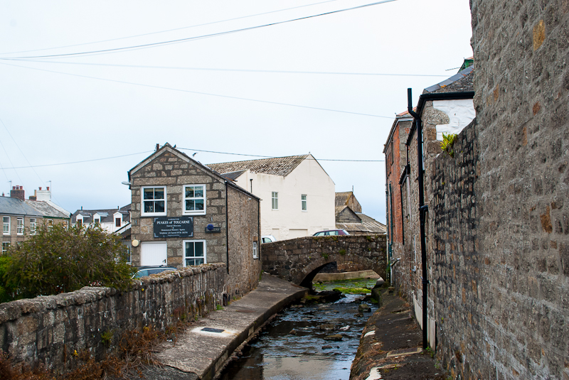 Walking past brick houses and back alleys in Newlyn along the south west coastal path in cornwall, england