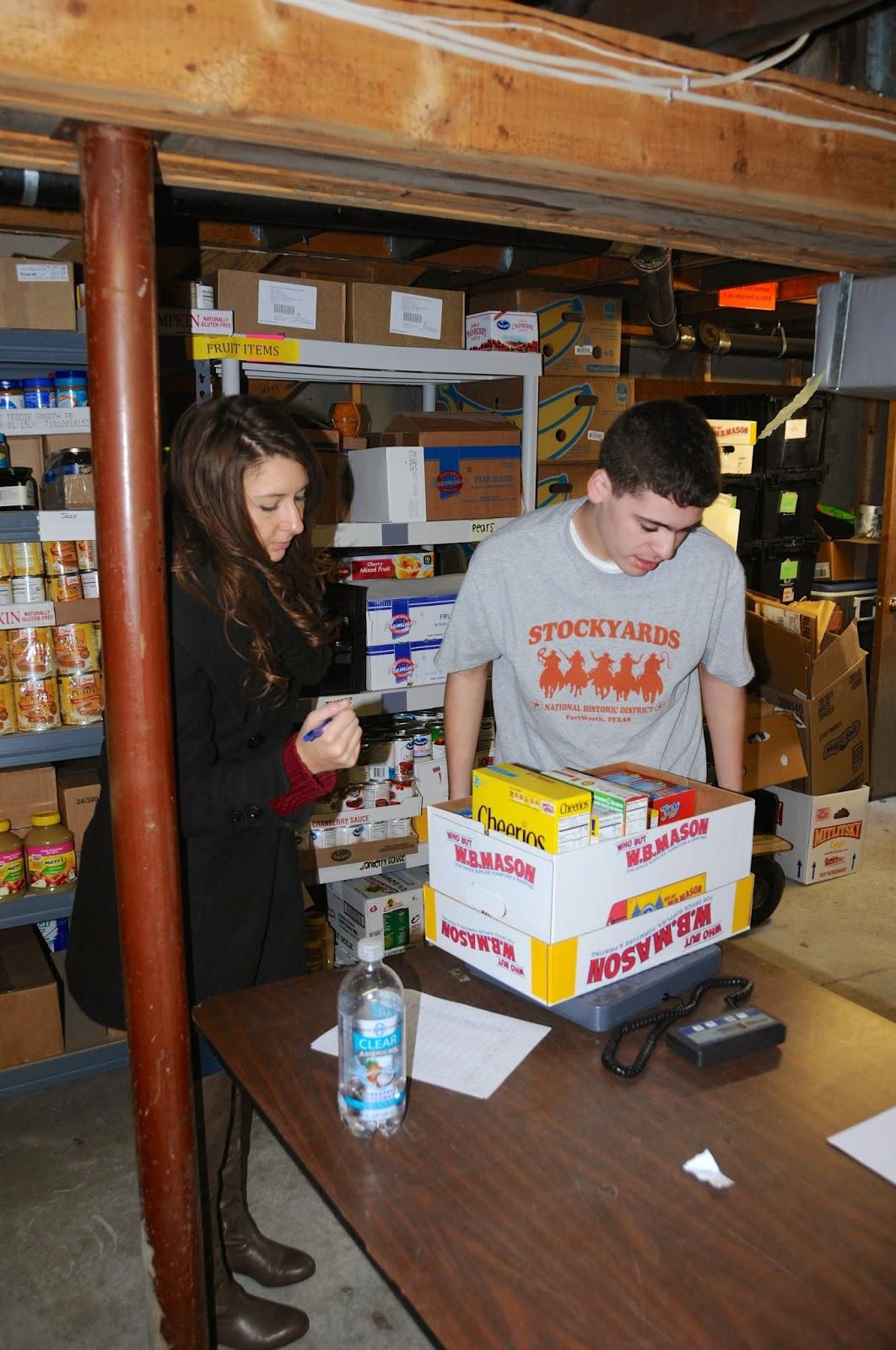 Student volunteers weigh donations
