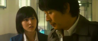 Kyung-gu Sol and Hye-jin Han in a scene of No Mercy by oceans movie reviews