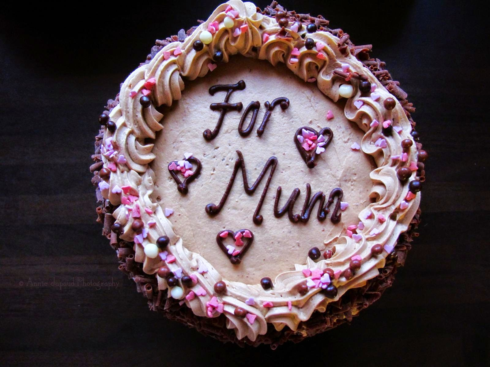 coffee cake with pink decoration and mum written on it