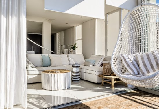 Safari Fusion blog | Whitewash | Sleek penthouse style with white floor tiles and furniture Latitude Green Point Cape Town, South Africa