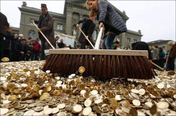 Streets Basel paved gold 15 TONS cent coins dumped citys streets protesters demand increased minimum wage