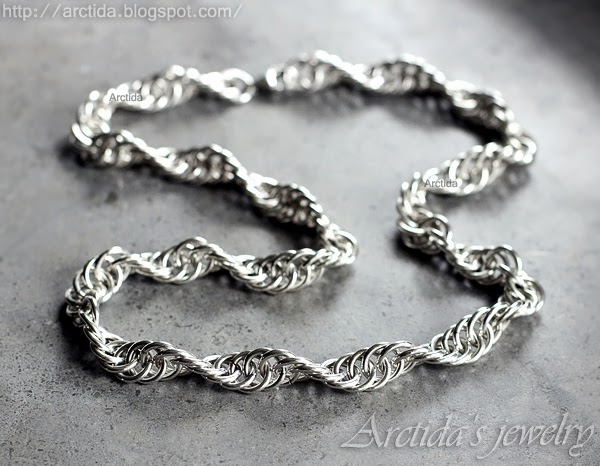 http://www.arctida.com/en/for-men/96-mens-necklace-chainmaille-cross-pendant-oxidized-sterling-silver.html