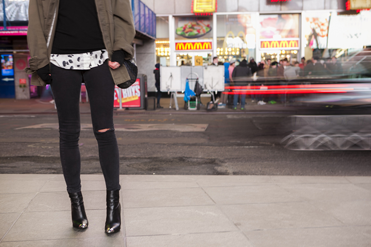 Asos distressed skinny jeans, hole in the knee, black denim, Zara pointy toe stiletto booties, cap toes, nighttime New York City streets, dalmatian print silk blouse