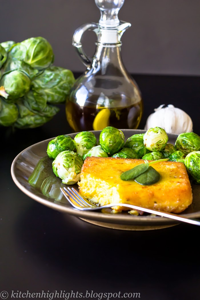 Fried cheese polenta served with roasted Brussels sprouts and a drizzle of homemade garlic and sage oil for a hearty, comforting dish