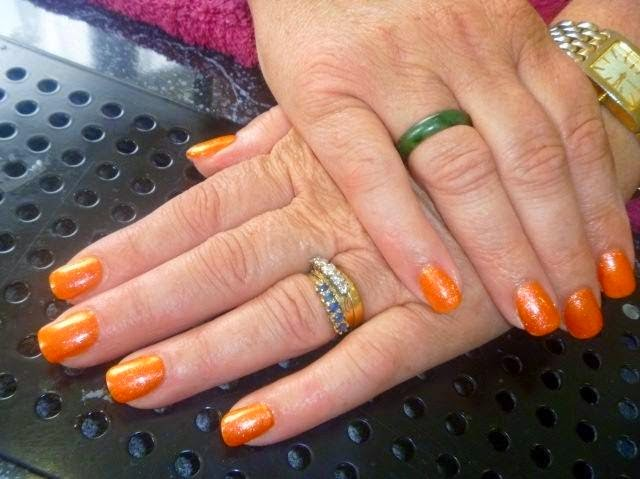 Acrylic extensions + LED polish manicure with silver foil and checkered black nail art-custom mix orange LED polish manicure with gelish glitz overlay