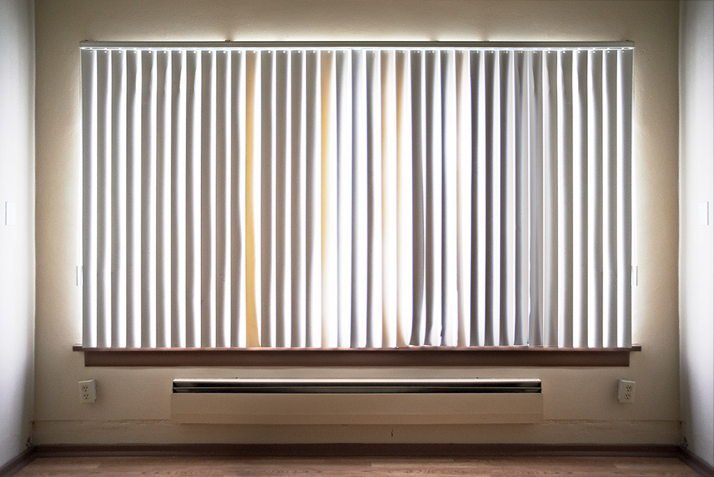 Here is photograph by andreas warren matti aka awm goes crazy. This image displays his window with shades, in seattle.