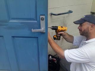 keyworks locksmith in mechanicville working on a business lock