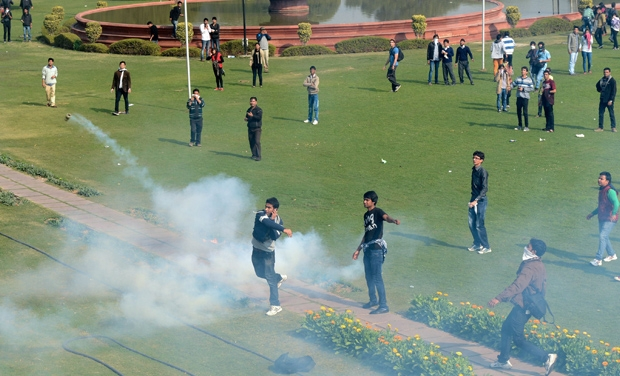 Protestors threw back tear gas bombs