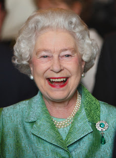 Queen Elizabeth wearing a green outfit. In 2011 she became the first sitting UK monarch to visit the Republic of Ireland.