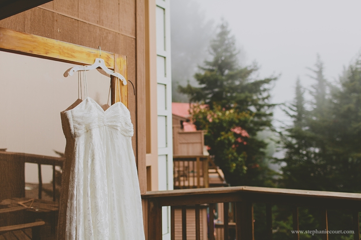 """wedding dress hanging in mountain fog mill valley"""