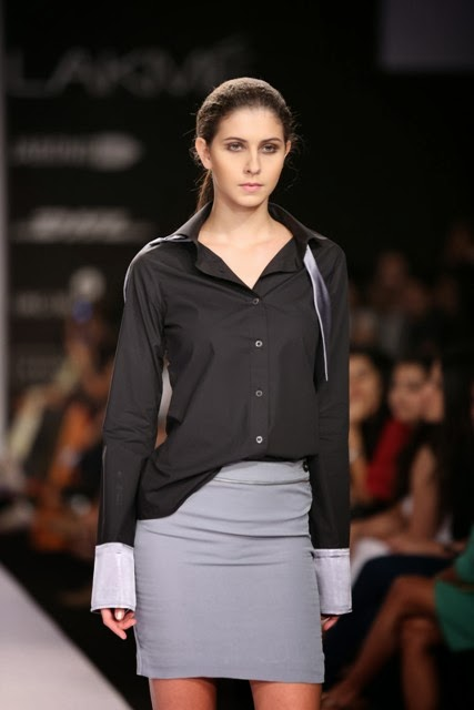 Dhruv Kapur's label DRVV for his collection reflected duplicity and duality in monochromes at Lakmé Fashion Week Summer/Resort 2014.  To match the theme and mood of the ensembles, the fabrics he opted for, started with double sided crêpe, georgette, cotton sateen, organza, silk flat chiffon and twill but stayed away from dazzling embroidery and bright colours. Dhruv played with black, white, grey, silver-grey and beige for a stylishly simplistic collection which had a great story to tell. The contrast French cuff and built in bow shirt in poplin seen below is my pick from the womens offerings.