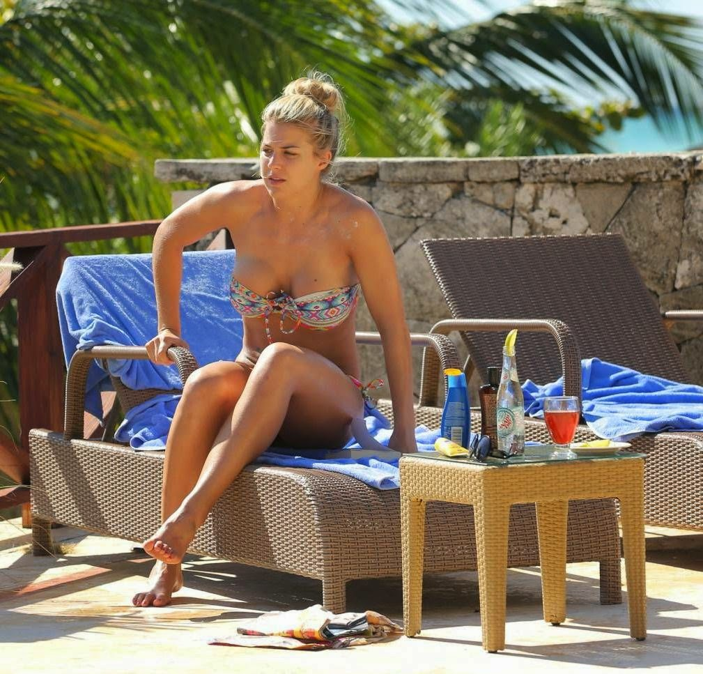 What's the point of being poolside if you aren't going to take it almost all perfect? At least, Gemma Atkinson was at peace with her decision, even if it made us a little sad as she made sure all eyes were firmly fixed on her with some questionable poolside etiquette. The 29-year-old continued her holiday break in Bali, Indonesia on Saturday, August 2, 2014, with relaxing on a sun lounger and reading a book.