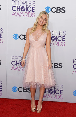 Kaley Cuoco wearing short pink Christian Siriano dress walked the red carpet at People's Choice Awards in LA