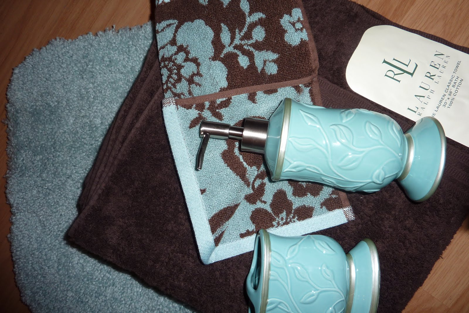 Colors of curacao brown aqua bathroom color inspiration for Aqua colored bathroom accessories