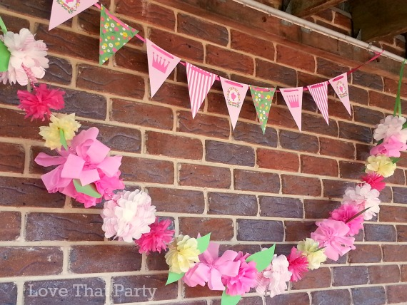 Image of princess party paper supplies, garland, bunting, paper flowers